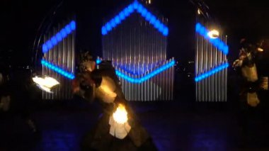 Guys beautifully perform with fire poi on the fire show
