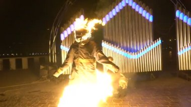 Stuntman with a burning head on the fire show