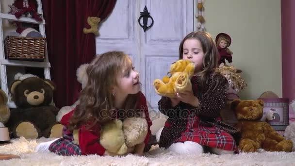 Little girls in a room where there are a lot of soft toys and dolls, slow motion