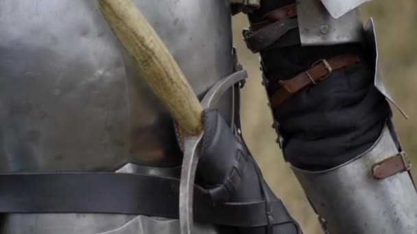 Medieval knight in armor and sword on the belt