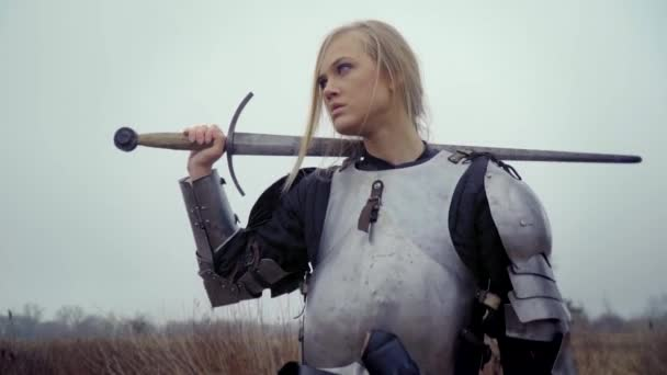 Jeanne dArc in armor with a sword on her shoulder
