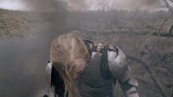 Jeanne dArc stands in smoke and yells fiercely