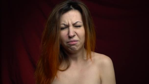 The girl shows that she is disgusting and she now vomits