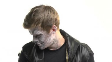 Body art of a raccoon on the face of a guy on a white background. Animal Make up