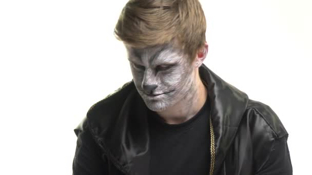 Body Art Raccoon on the face of a guy who turns his head and grins proudly. Animal Make up
