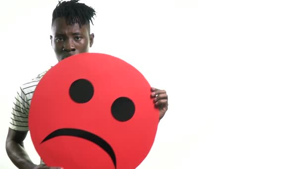 Black man raises a smile and shows that he is angry