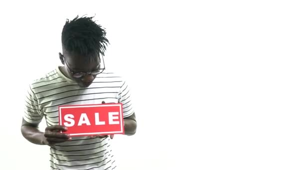 Happy black man looking at the sale sign in hands