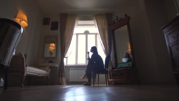 A room in retro style where a young girl sits alone