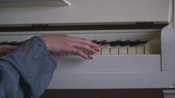 A young maiden hand gently touches the keys