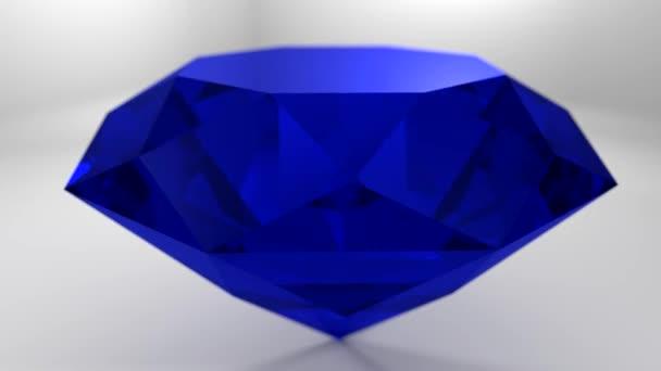 Sapphire blue diamond gemstone gem stone spinning wedding background loop 4K