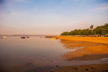 Beautiful dawn on the beach in Sanur.