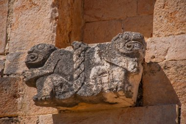 Ancient Mayan sculptures in stone. Yucatan, Mexico. Ruins of Uxmal.