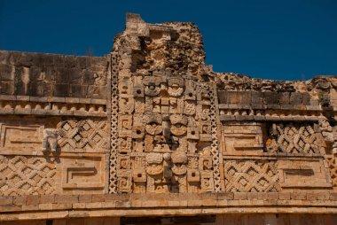 Ancient Mayan drawings on stone. Fragment. Yucatan, Mexico.Uxmal