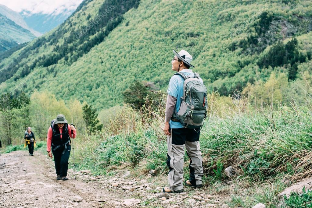 people hiking in mountains
