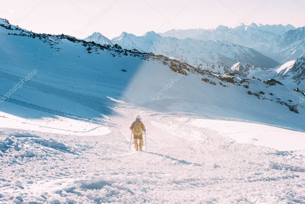 climber man in snowy caucasus mountains
