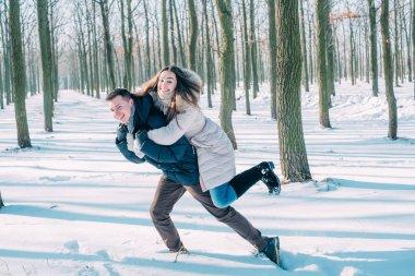couple having fun in snowy park