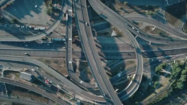 aerial view of a large freeway interchange with cars and railway