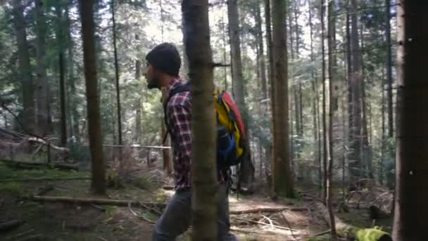 man hiking in the forest with backpack
