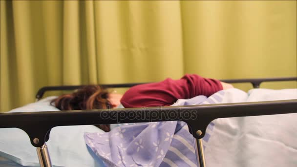Woman patient lying on a bed in a hospital room