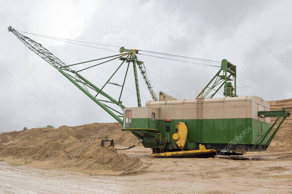 machine on sand quarry on a rainy day