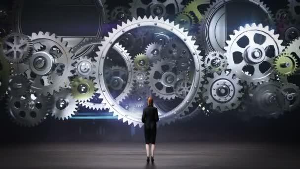 Businesswoman standing big Gear wheels, connecting gear wheels.