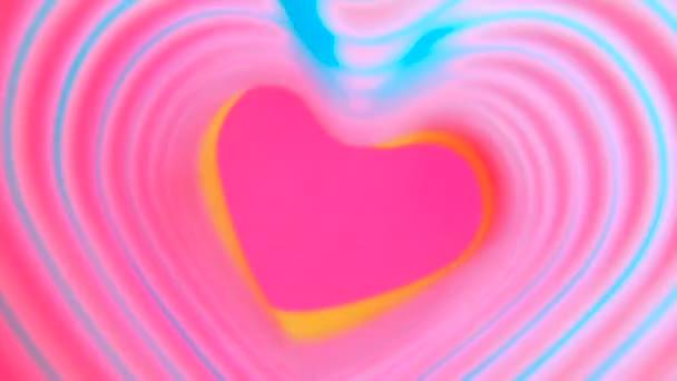 Barevné tluče srdce Rainbow jarní. Valentines Day koncept. Růžové srdce rám Zpomalený pohyb. LGBT glbt znamení