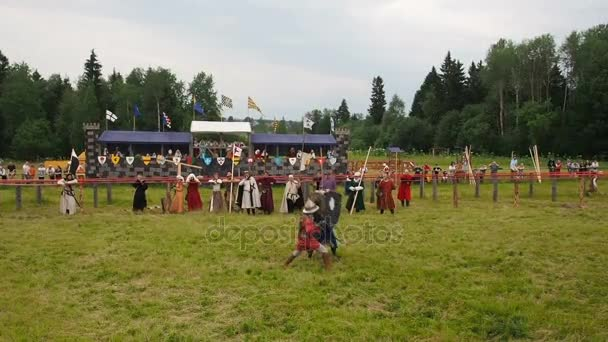 RITTER WEG, MOROZOVO, JUNE 2016: Festival of the European Middle Ages. Medieval joust knights in helmets and chain mail battle on swords with shields in their hands