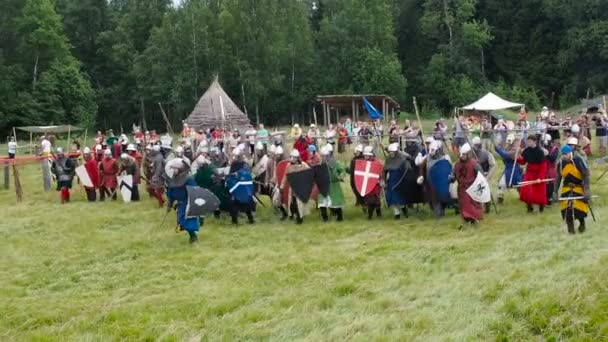 RITTER WEG, MOROZOVO, JUNE 2016: Festival of the European Middle Ages. Medieval joust with knights and spears in armour and costume fight wall to wall