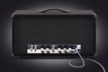 guitar amplifier with inserted audio cable