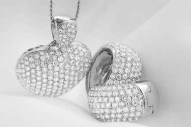 White gold earrings and heart shaped necklace with white diamonds