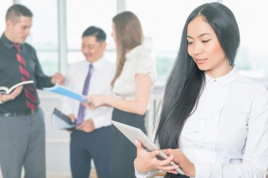 Asian business woman using tablet PC. Online banking