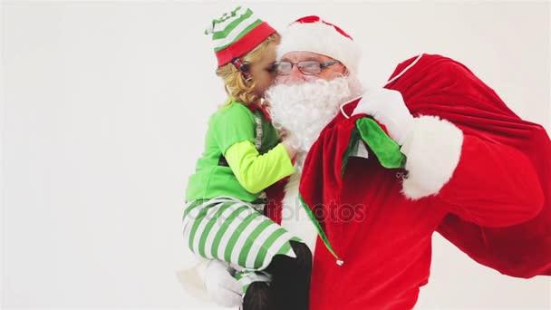 Weihnachtswunsch 2016. Santa Claus und kleine Mädchen. Wünsche zu sagen