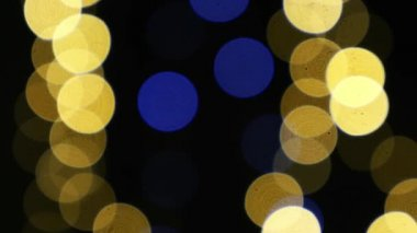 Abstract background of Christmas golden light bokeh. New Year