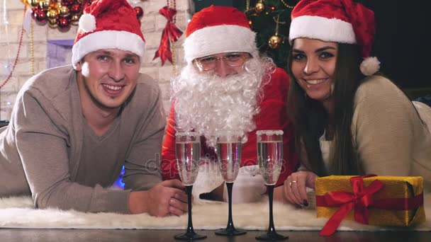 Young couple with Santa celebrating New Year 2017, Christmas