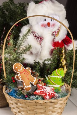 Christmas cookies in the basket and Santa Claus