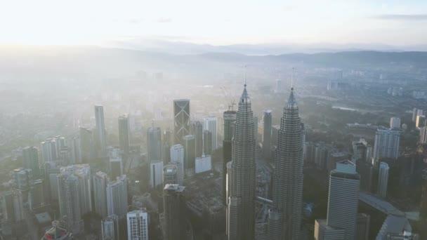 Drone flying above Kuala Lumpur city skyline