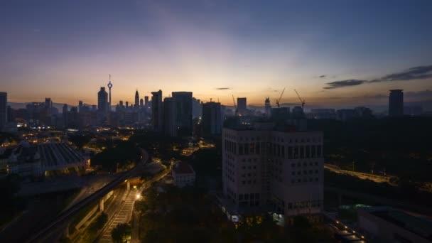 4k time lapse of sunrise at Kuala Lumpur city skyline. Pan left