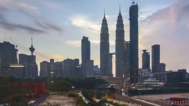 4k time lapse of sunset at Kuala Lumpur city skyline. Pan right