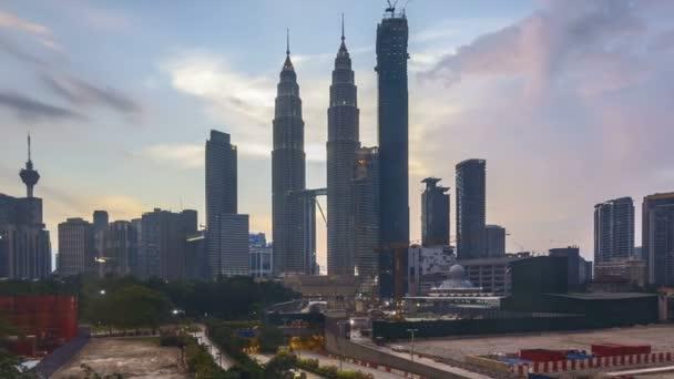 4k time lapse of sunset at Kuala Lumpur city skyline. Pan left