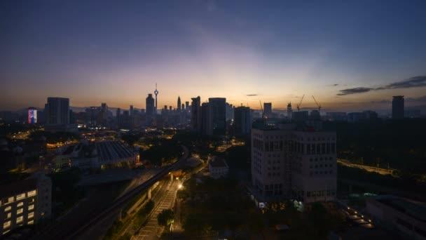 4k time lapse of sunrise at Kuala Lumpur city skyline.