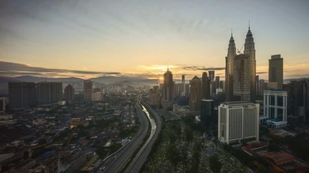 4k time lapse of sunrise at Kuala Lumpur city skyline. Pan right
