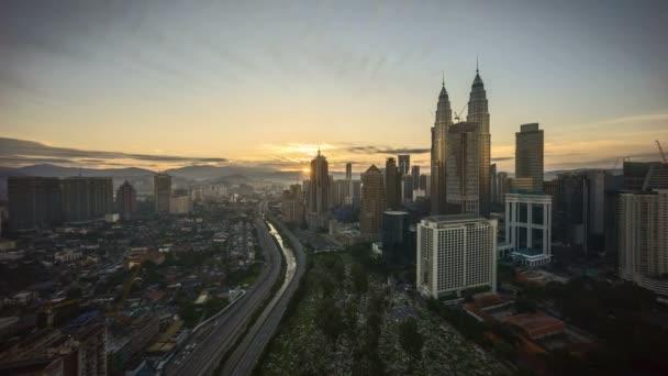 4k time lapse of sunrise at Kuala Lumpur city skyline. Zoom in