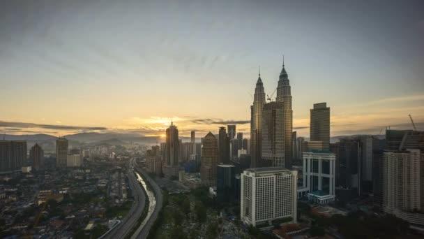 4k time lapse of sunrise at Kuala Lumpur city skyline. Tilt down