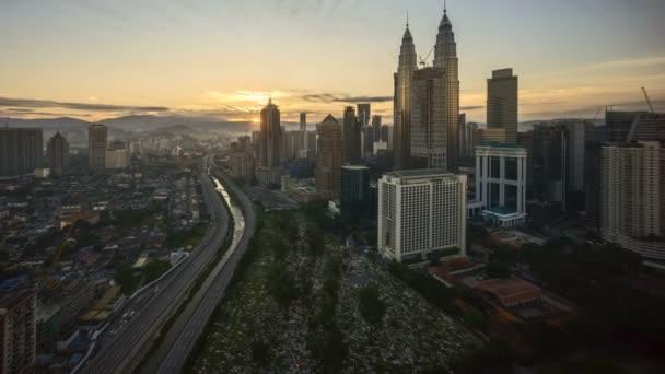 4k time lapse of sunrise at Kuala Lumpur city skyline. Tilt up