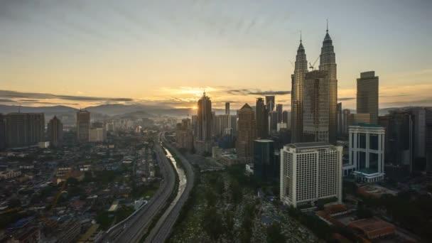 4k time lapse of sunrise at Kuala Lumpur city skyline. Zoom out
