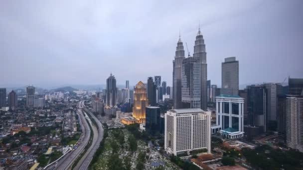4k time lapse of sunset at Kuala Lumpur city skyline. Tilt down