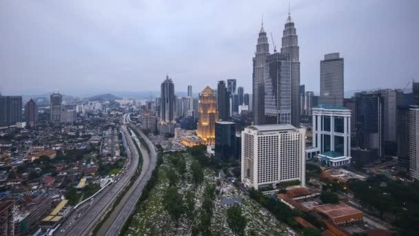 4k time lapse of sunset at Kuala Lumpur city skyline. Tilt up