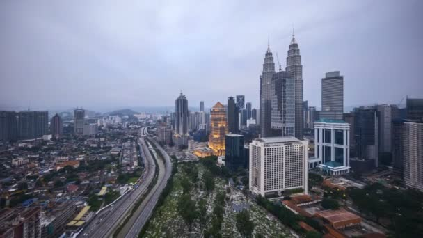 4k time lapse of sunset at Kuala Lumpur city skyline. Zoom in