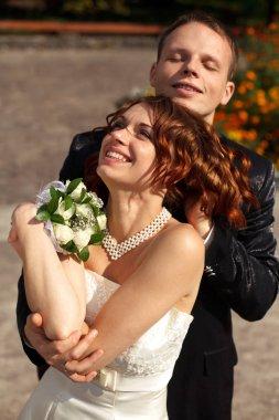 groom massages bride's head