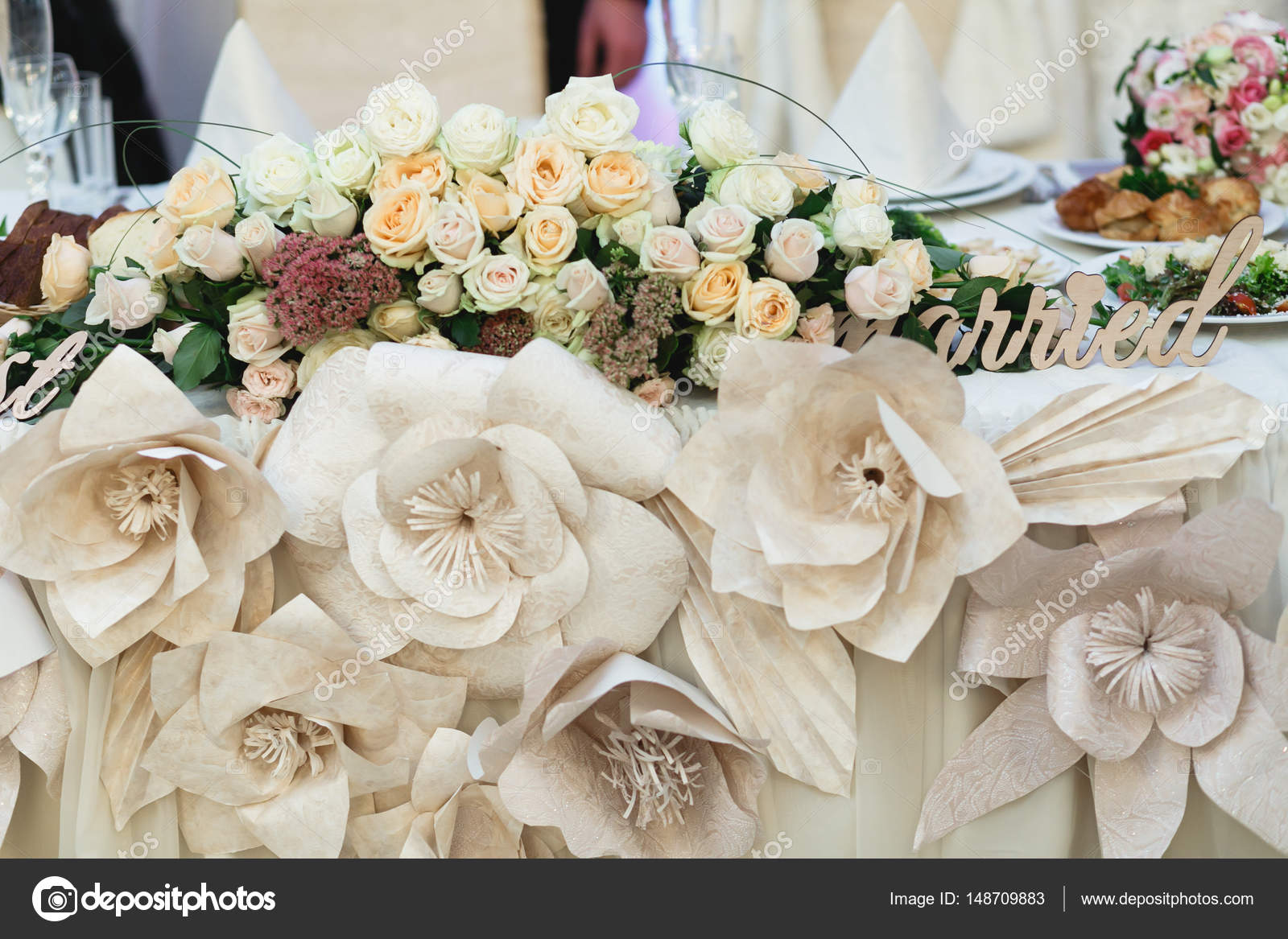 Beig Cloth Flowers As A Part Of Dinner Table Decoration Stock